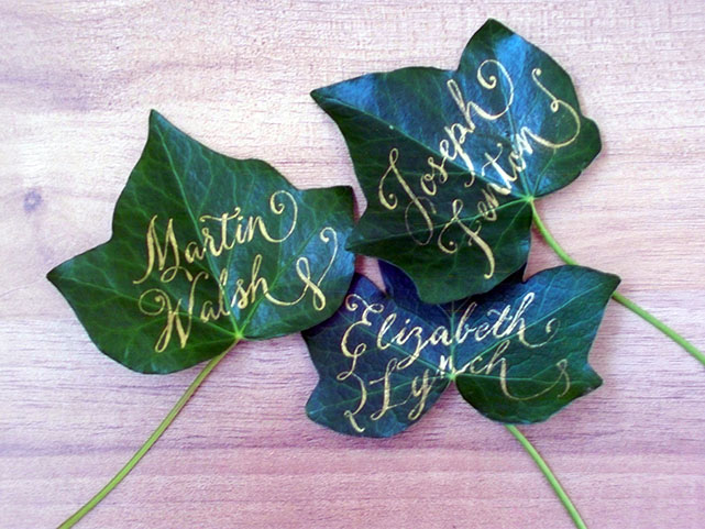 Calligraphy on Ivy leaves in gold ink