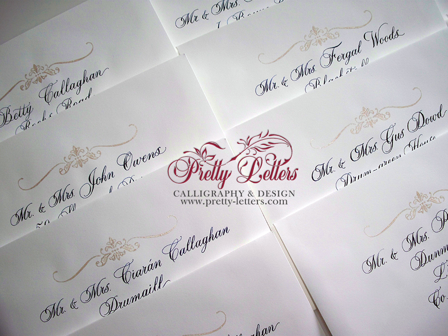 Envelope art work in soft gold and calligraphy in navy ink