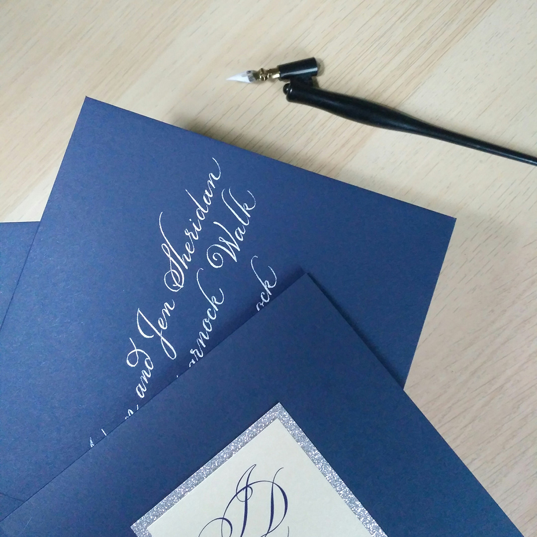 navy envelopes/white calligraphy